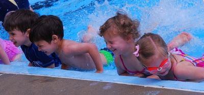 Kids attending swimming lessons.